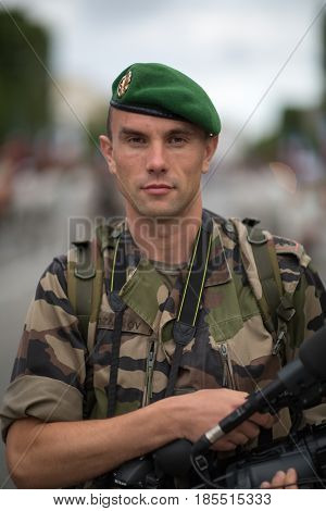 Paris France - July 14 2012. Legionnaire photographer of the French Foreign Legion takes part in the annual military parade in honor of the Bastille Day.