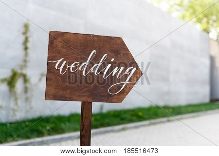 Wedding decor. Wooden plaque with the inscription in paint Wedding. Wood hand made signboard, welcome wedding decoration.