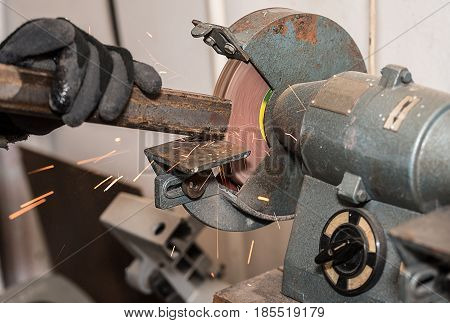 Industrial Metal Worker Use The Grinding Machine