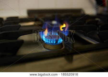 kitchen and cooking concept - burning gas stove flame