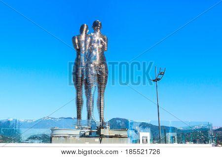 Batumi, Georgia - April 30, 2017: Moving metal sculpture created by Georgian sculptor Tamara Kvesitadze in 2007, titled Man and Woman or Ali and Nino.