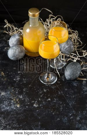 Traditional Italian Yellow Egg Liquor, Bombardino. Dark Backgrou