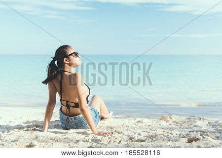 Young fashion woman relax on the beach. Happy island lifestyle. White sand blue cloudy sky and crystal sea of tropical beach. Vacation at Paradise. Ocean beach relax travel to Maldives islands. woman relax. woman relax beach. woman relax vintage. woman re