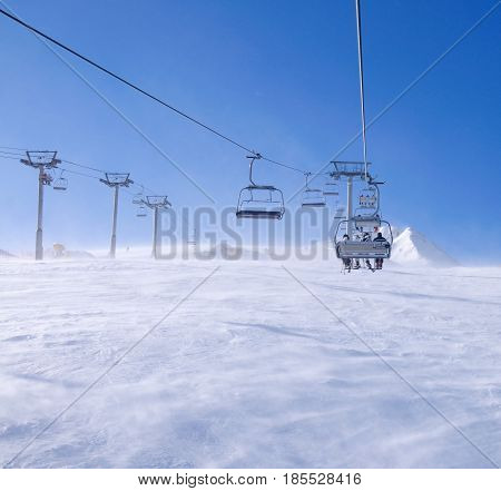 Skiers on a ski-lift in Pirin national park Bansko Bulgaria