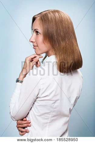 Young woman with good mainted fair hair. Over blue background