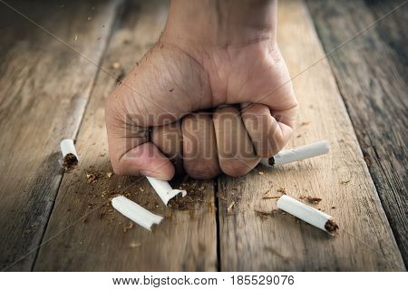 Men hand crushed some cigarettes No Smoking Quitting smoking and healthy lifestyle