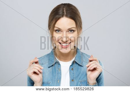 Shot Of Positive Smiling Happily And Wide Young European Woman Isolated On Grey Background Showing G