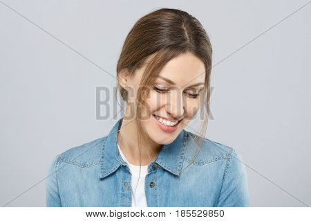 Photo Of Good-looking Woman Dressed Casually Isolated On Gray Background With Eyes Looking Down In S