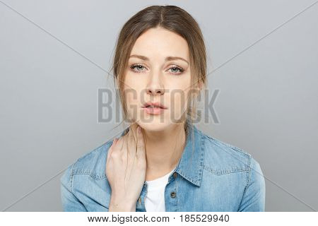 Picture Of Tired Beautiful Girl Dressed Casually Isolated On Gray Background With Expression Of Stre