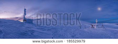 Winter sunset snow field on top of mountain under colorful sky.Vitosha Bulgaria