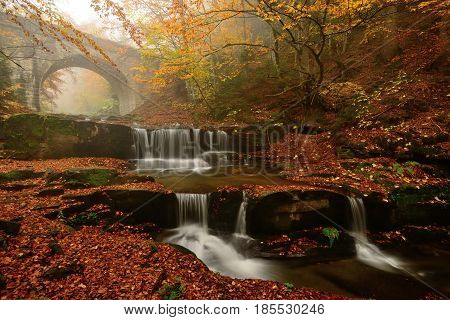 Autum colors waterfalls and bridge in Rodopi mountain