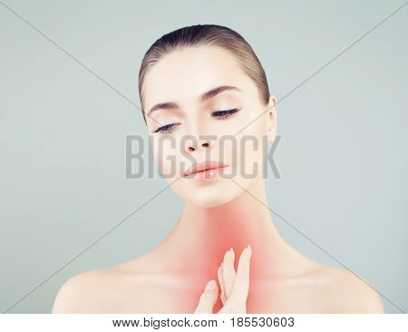 Young Woman with a Sore Throat. Woman Puts Hands on the Neck