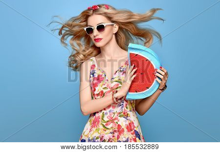 Fashion Beauty woman in Summer Outfit. Sensual Sexy Blond Model in fashion pose Smiling. Trendy Floral summer Dress, Stylish wavy hairstyle, fashion Flower Hairband. Playful Happy Romantic summer Girl