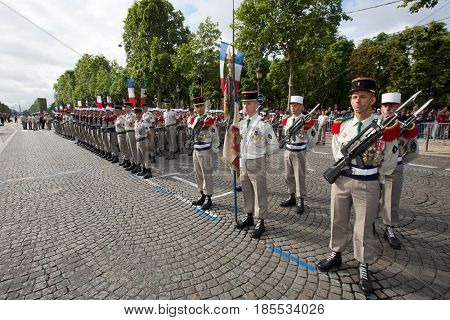 Paris France - July 14 2012. Soldiers from the French Foreign Legion march during the annual military parade in honor of the Bastille Day in Paris.