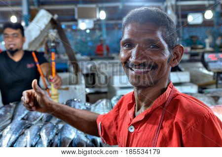 Bandar Abbas Hormozgan Province Iran - 15 april 2017: A Persian handyman at a fish market smiles a close-up portrait.