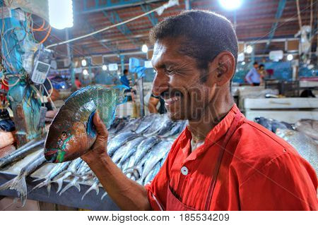 Bandar Abbas Hormozgan Province Iran - 15 april 2017: Close-up portrait of a cheerful Persian worker in the fish market.