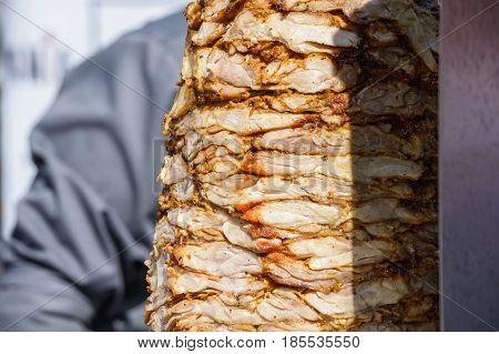 Close up kebab meat on vertical skewer