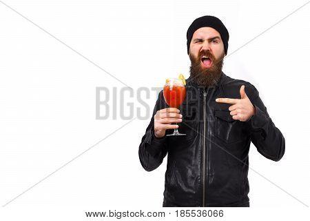 Brutal Caucasian Hipster Holding Alcoholic Beverage Or Fresh Cocktail