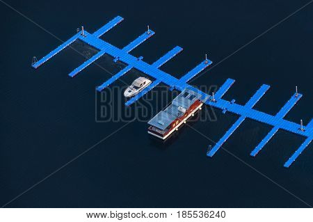 A pier at the Slapy dam with an anchor houseboat. Aerial photo.