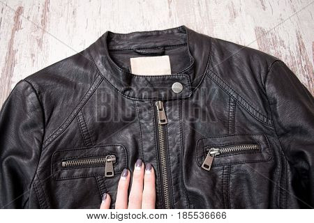 Black Leather Jacket With A Zipper And A Female Hand. Fashion Concept, Close Up