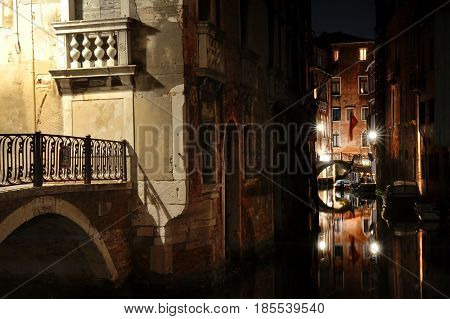 Venice by night - view of a canal and a bridge Venezia Italy