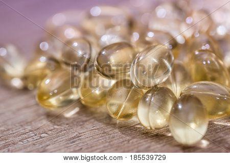 Many Cod Liver Oil Omega 3 Capsules On Desk