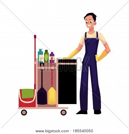 Boy, man, cleaner in overalls with cleaning trolley, cartoon vector illustration isolated on white background. Full length portrait of young man, boy with professional cleaning trolley