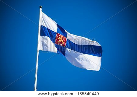 Finland state flag flying against clear blue sky