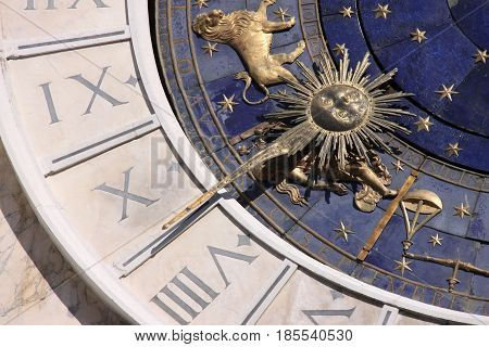 A blue grey and gold astrological astronomical clock in Venice
