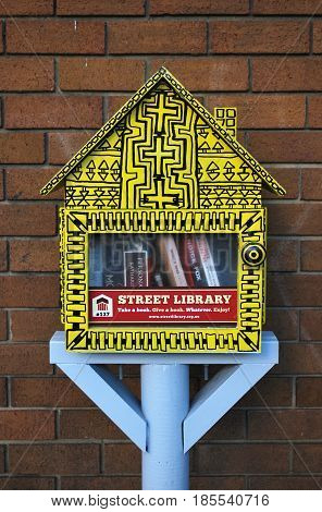 SYDNEY AUSTRALIA - MAY 01 2017: Street library in the form of a little yellow booth with free books. Box is used as a library exchange.