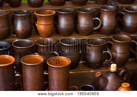 Clay pottery ceramic Products dry on shelf in workshop.
