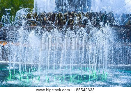 The gush of water of a fountain.