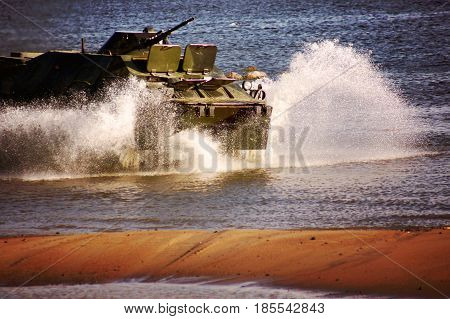 A Military Tank Rides On The Water, Scattering Water Splashes