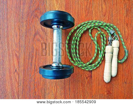 Dumbbell and jump rope or skipping rope in gym