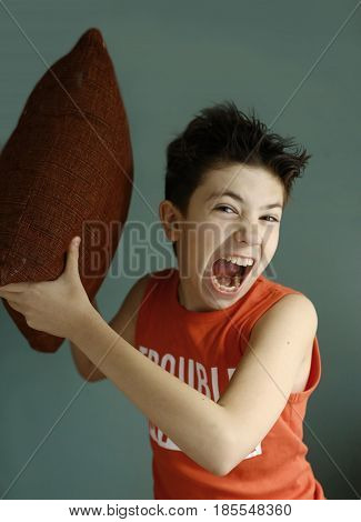 Teenager Mischivous Boy Fighting With Pillow Open Mouth