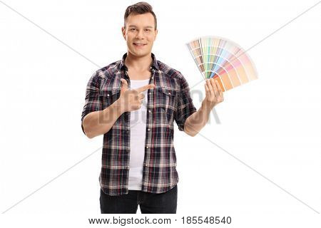 Man holding a color swatch and pointing isolated on white background