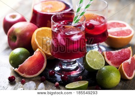 Sangria in pitcher with citrus fruits homemade refreshing lemonade drink