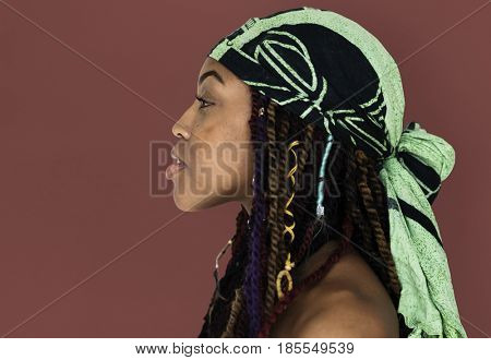 African Woman Bare Chest Side View Studio Portrait