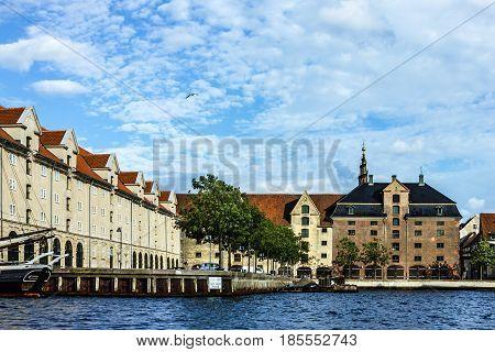 Copenhagen, Denmark - May 5, 2017: Sea front and historical buildings in Copenhagen, Denmark