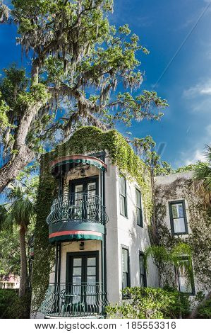 Green Ornate Balconies on Southern Apartment under Spanish Moss