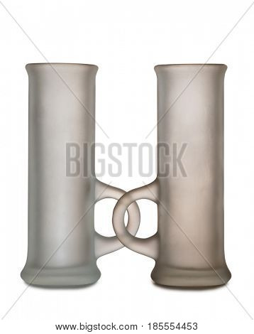 Glass cups with liquor on white background