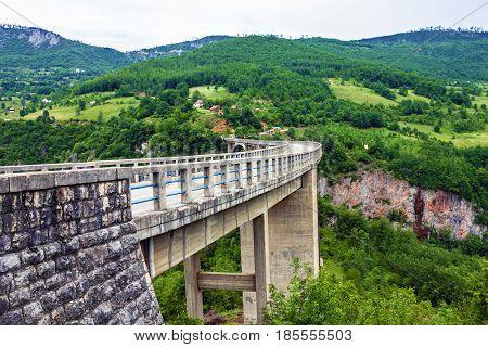 Mountain landscape, Montenegro. Durdevica Tara arc bridge in the mountains