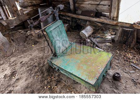 Old scale in desolate Mashevo village in Chernobyl Exclusion Zone Ukraine