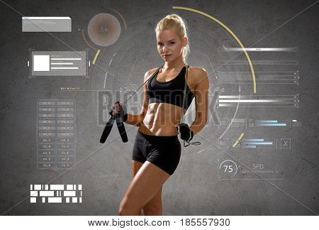 sport, fitness, training, stamina and people concept - young sporty woman with jumping rope over gray concrete background