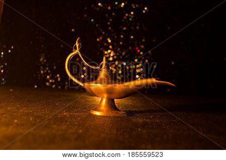 Antique Aladdin Arabian Nights Genie Style Oil Lamp With Soft Light White Smoke, Dark Background. La