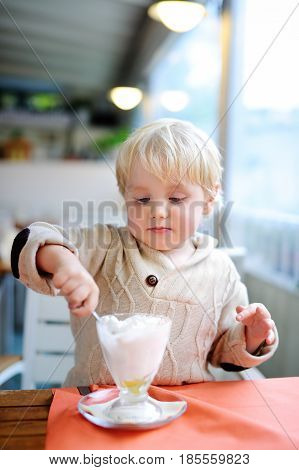 Cute Little Boy Eating Ice-cream Gelato In Italian Indoors Cafe