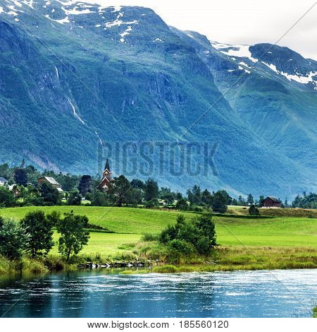 Landscape with mountain and lake in Norwegian village Olden.