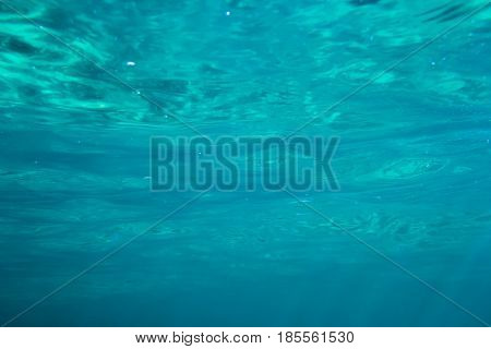 Texture of blue water in tropical ocean. Underwater blue background
