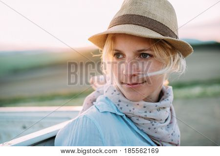 adventurer woman portrait at sunset