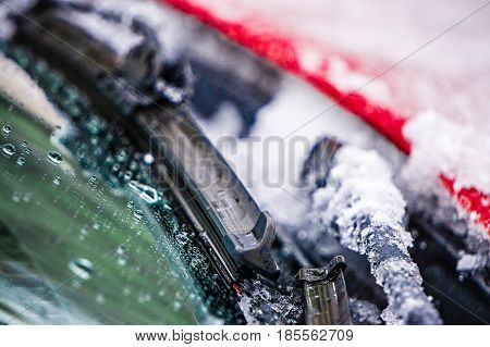 a snow and ice covered windshield wipers